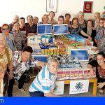 Los mayores de San Miguel compran alimentos para repartir a familias con menos recursos